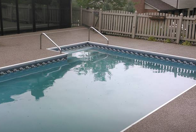 Concrete pool deck with texture finish for a non slip surface in Sylvania, Ohio