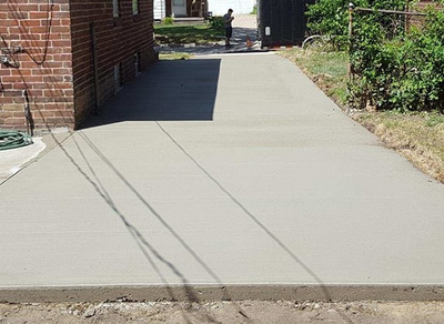 New driveway along the side of a red brick home in Savannah, GA