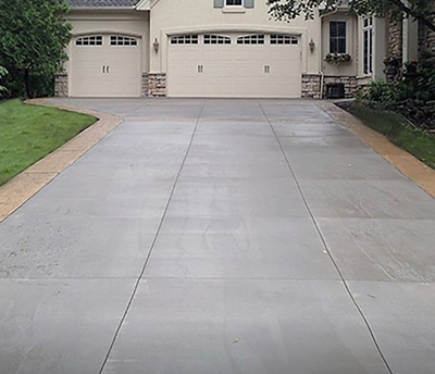 Concrete driveway with a stamped, colored concrete border