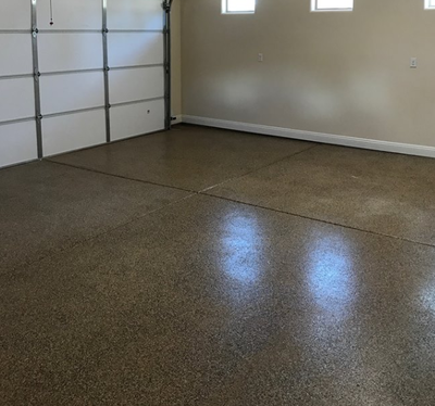 Dark stained concrete garage flooring with texture for no slip surface in Oregon, Ohio