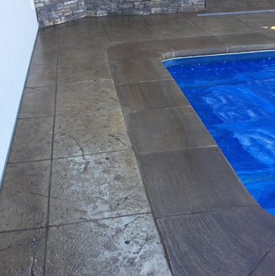 Two tone stamped concrete pool decking at Maumee, Ohio home