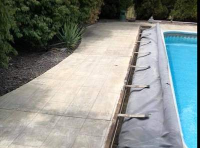 Decorative concrete pool deck at this Oregon, Ohio residence.