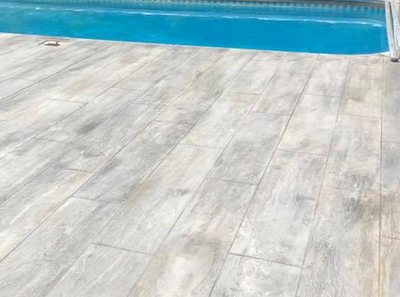 Laminate finish concrete pool decking at Rossford resident's home
