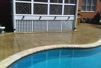 Two toned stained concrete pool decking in Rossford, Ohio
