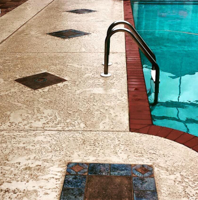 Sealed concrete pool decking with brick paver trim and diamond design in Waterville, Ohio