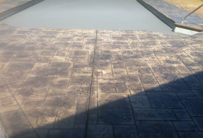 Dark stained concrete stamped with brick paver finish in Findlay, Ohio